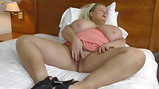 This nasty housewife with huge breasts goes all the way