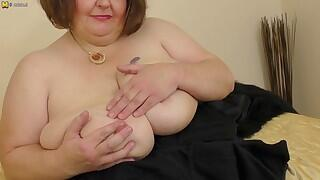 Naughty big breasted BBW frolicking with herself